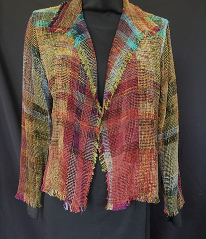 Handwoven fringed jacket of rayon chenille, cotton and bamboo yarns