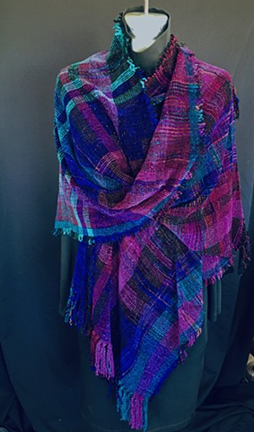 Handwoven triangle shawl of rayon chenille, cotton and bamboo yarns.