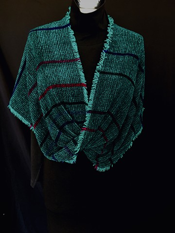 handwoven twisted shawl of rayon chenille, cotton and bamboo. Knotted fringe.