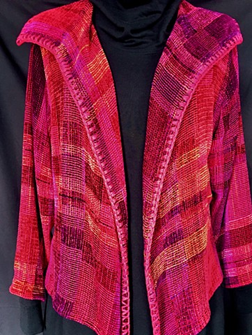 Handwoven lapel jacket of rayon chenille, cotton and bamboo yarns.