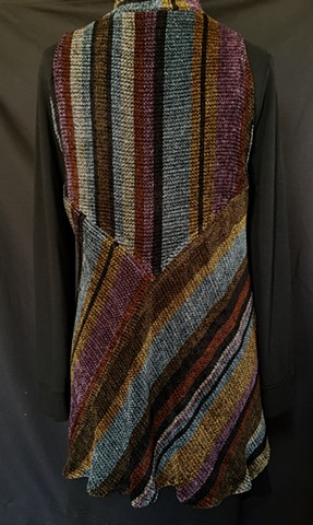Handwoven long vest of rayon chenille, cotton and bamboo yarns.