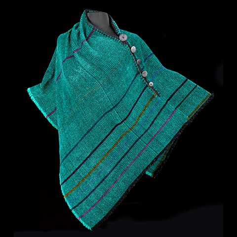 Handwoven Poncho of rayon chenille, cotton and bamboo yarns.  Hand-embellished with crochet and buttons.