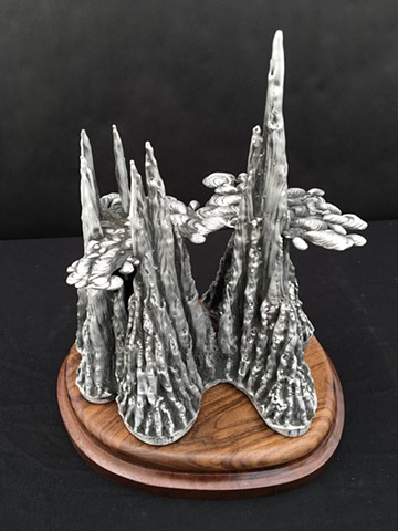 aluminum sculpture stalactite stalagmite contemporary art artist foundry