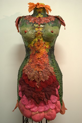 Body Form Decorated with Leaves, Flowers and Fabric.