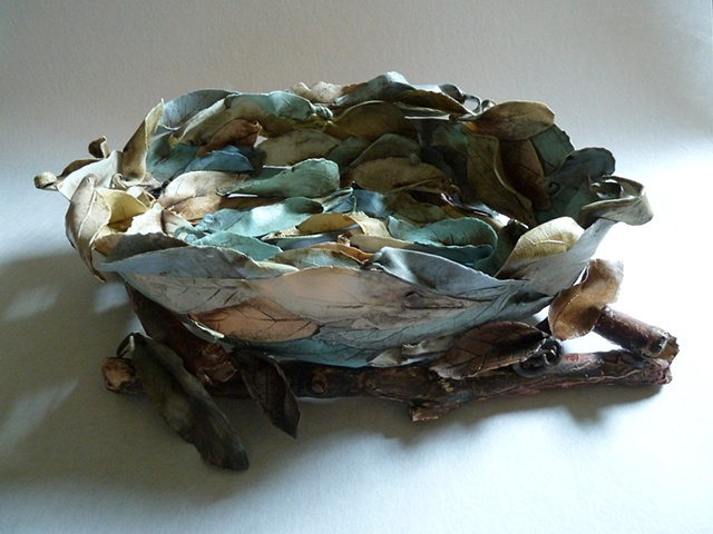 Porcelain leaves create this bowl resting on casted porcelain branches.
