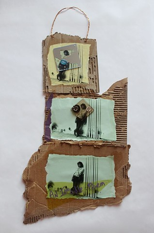 PETERS   #4 Peter collaged on three torn carton panels with copper wire hanger  28 x 13 inches  2017