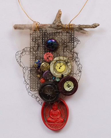 "INSPIRED BY JOSEPH CORNELL ""Buttons & Beads With Red Buddha Dangle"" Detail"