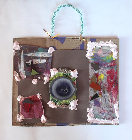 MIX 2017  #4 Agate centerpiece, mirrored shards on torn painted paper fragments, homemade caulk on torn carton with wire hanger   2017