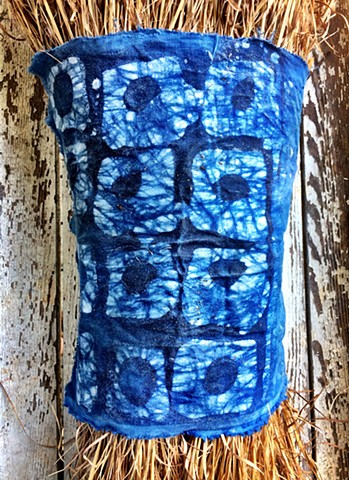 Indigo dye and batik on cotton wrapping a Sedge Broom bundle.