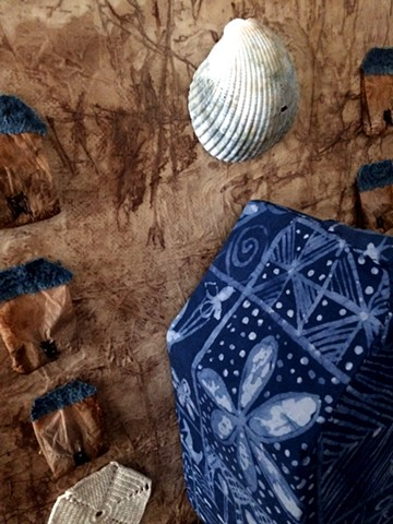 Close up to show indigo dyed batik on The Big House centerpiece of a triptych.