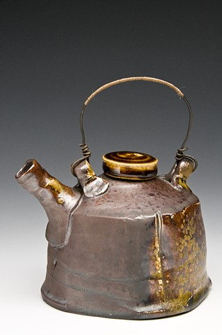 Woodfired porcelian teapot teapot with wire and tread handle