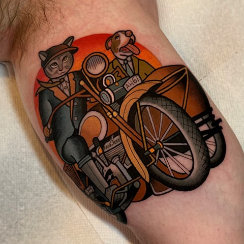 cat and dog and motorcycle tattoo by dave wah at stay humble tattoo company in baltimore maryland the best tattoo shop and artist in baltimore maryland