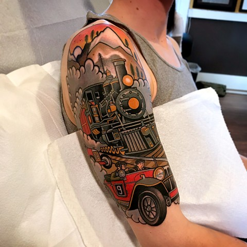 car racing tattoo by dave wah at stay humble tattoo company in baltimore maryland the best tattoo shop and artist in baltimore maryland