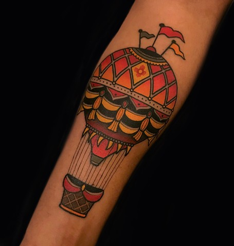 hot air balloon tattoo by dave wah at stay humble tattoo company in baltimore maryland the best tattoo shop and artist in baltimore maryland
