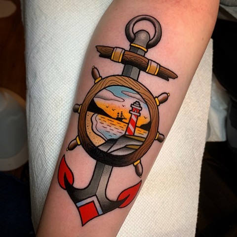 anchor and lighthouse tattoo by tattoo artist dave wah at stay humble tattoo company in baltimore maryland the best tattoo shop in baltimore maryland