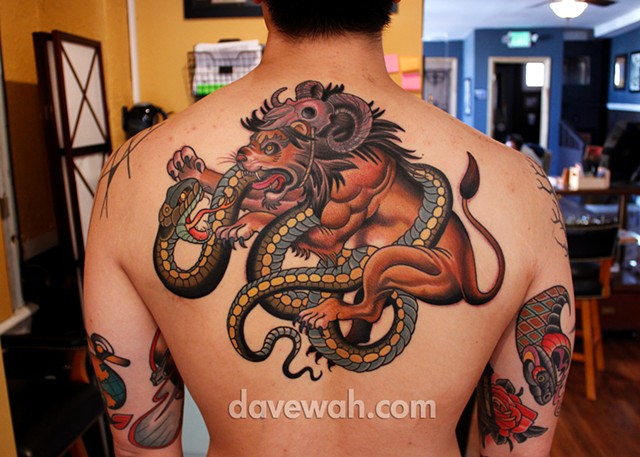 lion fighting snake tattoo by dave wah at stay humble tattoo company in baltimore maryland