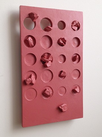 "An abstract sculpture. A painted wood, wall relief with marble chip inclusions. ""How's to judge? 2015, by Robert Fields"