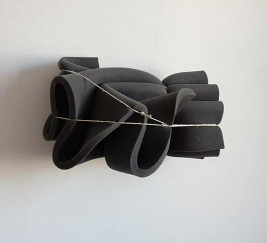 Contemporary, post minimalist, sculpture, wall hung, made of hi-density, closed cell foam and string. Robert Fields, 2018.