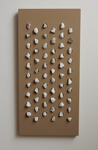 A wall relief, influenced by minimalism, situated somewhere between painting and sculpture. Acrylic paint and marble chips on a wood panel, 32-1/2 x 15-3/4 x 1-3/4 inches, by Robert Fields, 2015.