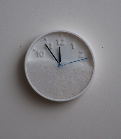 "Robert Fields, ""Moments and the passing of moments--this is life."" Ps 3:1-9. 2019. Wall clock (plastic, battery not included) & salt. 8"" Dia. x 1-1/2"" Depth."