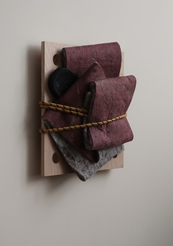 "Robert Fields, Contemporary art, conceptual, minimal sculpture. 2020. Media: Felt with flip-flop, rubber sandal on wood panel, bound-up with a bungee cord. 16"" H x 15"" W x 4-1/2"" D. Work informed by reading about survivors of trauma—whether abuse, acciden"