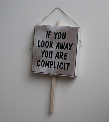 "Robert Fields, ""IF YOU LOOK AWAY,..."" --Ai Weiwei,  2019. Vinyl lettering, vegetable oil on corrugated paper board, with wood & twine. Speaks to all refugees seeking asylum. 24"" H x 13"" W x 2-1/4 "" D."