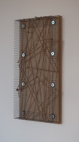 "Robert Fields, ""Papers please?"" 2019. Galvanized steel wire screening with copper, steel and rubber fasteners, jute twine, and acrylic paint on wood panel. 30 H x 14 W x 4-1/2 D Inches. Contemporary, sculpture in a minimalist manner."