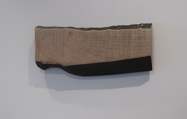 "Robert Fields, ""Me too."" 2019. Graphite over acrylic paint on waxed maple. 9 H x 21-1/2 W x 1-5/8 D Inches.Contemporary, low relief, wall sculpture."