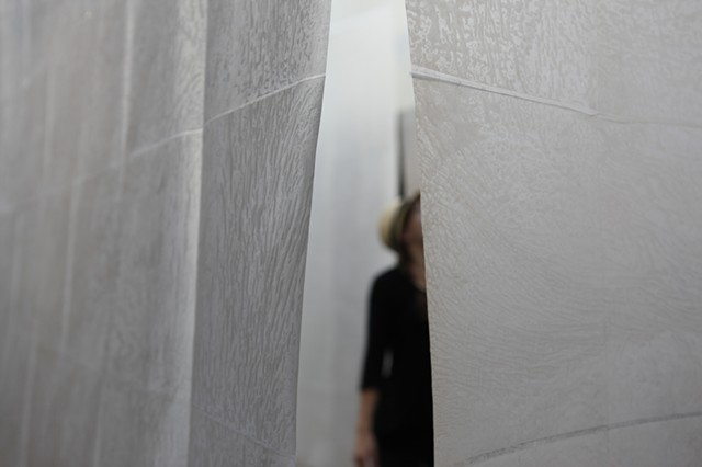 installation of suspended, woven, waxed paper walls hung from architectural skylight