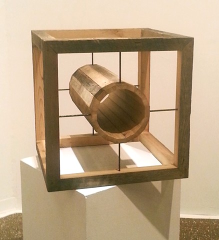 This wooden cube is made from 100 year old salvaged lumber and rusted steel rods.