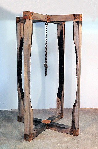 Sculpture created out of rough hewn tulip poplar wood and steel