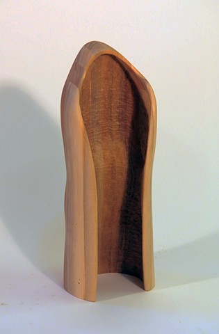 Laminated and carved walnut wood