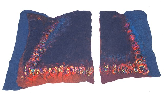 handmade felt wall piece made of dyed, unspun wool and yarns, by Sharron Parker. An abstract inspired by the volcanic forces which create geodes underground.