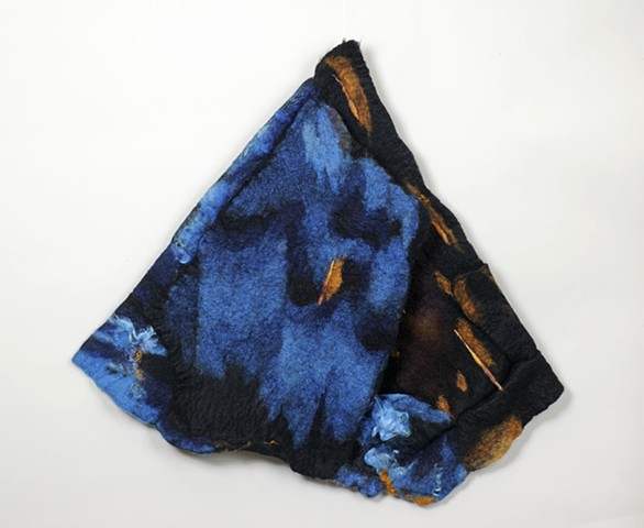 A handmade felt wall piece made of dyed unspun wool and alpaca, with wool yarns by Sharron Parker.  An abstract piece made after a storm where torrents poured over a mill dam in Vermont.