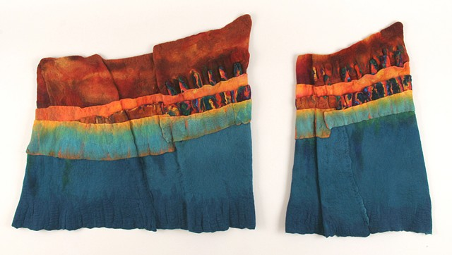 handmade felt wall piece made of dyed, unspun wool  by Sharron Parker. An abstract piece inspired by colors in an unusual piece of Roman glass.