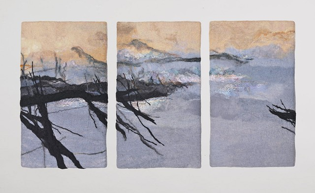 handmade felt wall piece made of dyed, unspun wool and yarns, by Sharron Parker.  A somewhat abstract landscape of trees, water, and  mountains.