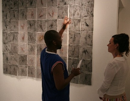 exhibition: PROGRESSIONS  Artist Connie Phieffer and friend discussing her work