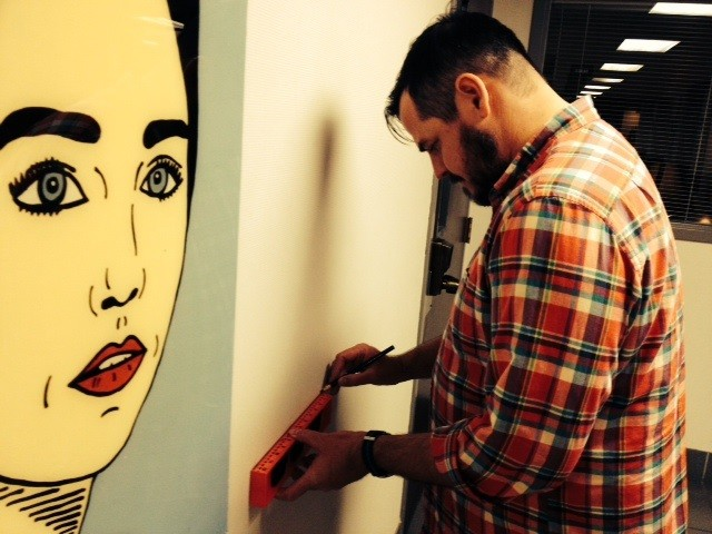 Installing a Derek Erdman painting on the eve of TOM and DEREK, Live! at the Tax Collector's Office