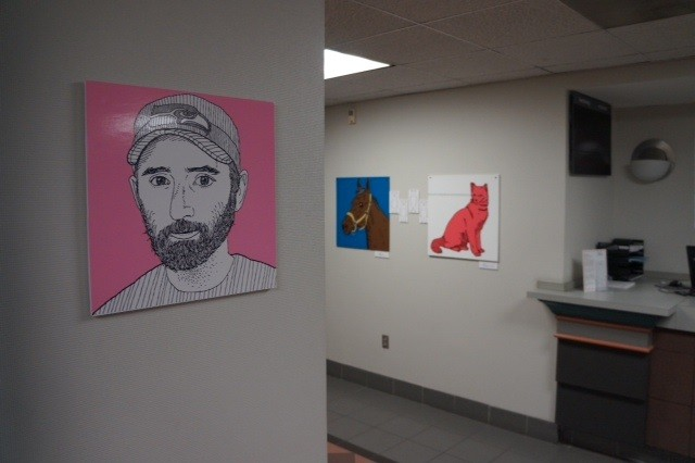 Installation view of Self Portrait | Pink by Tom DesLongchamp (foreground) and The Final Horse Story and Pink Cat With Really Good Vision by Derek Erdman (background)