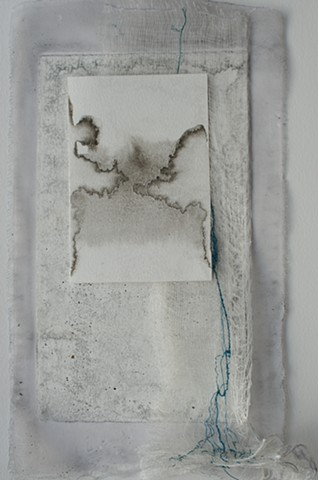 Silk, gauze, paper with ink and cascading blue stitching.