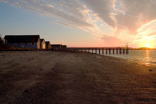 boat houses at sunrise