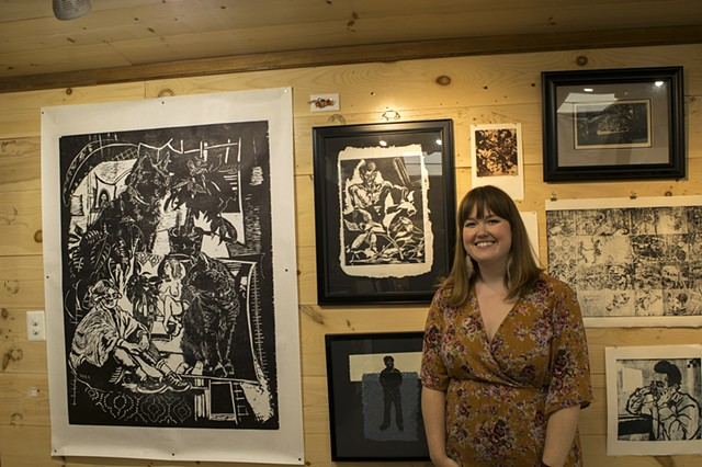Catherine Cole and some of her work on view at the Friends of Studio 797 exhibit