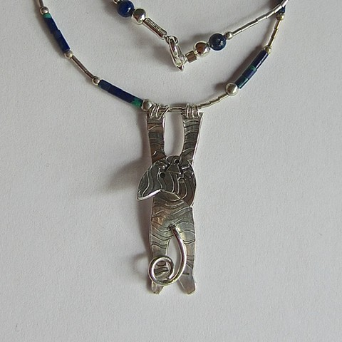 Hanging by the Nails Cat necklace