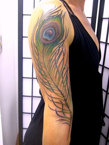 peacock feather tattoo by tattoo artist Sadie Kennedy, Sweet Trade Tattoo, Lahaina, Maui