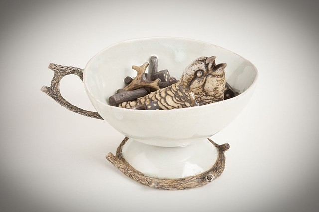 porcelain teacup with bird and sticks