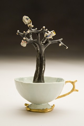 porcelain teacup with tree and houses