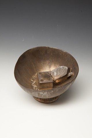 porcelain cup with bronze glaze