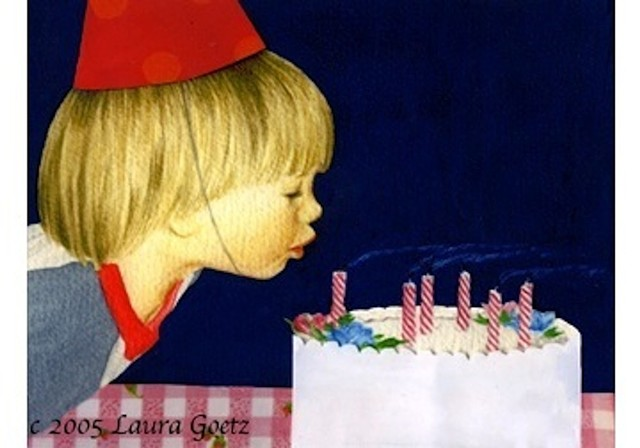 A little boy blowing out birthday candles.
