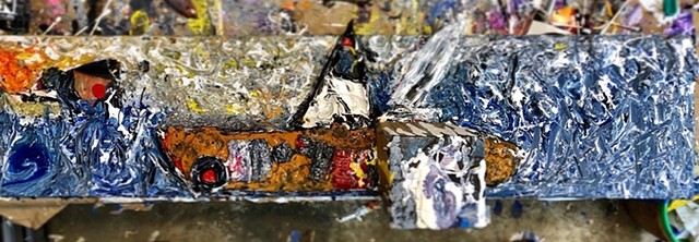 This found object sculpture painting uses expressionist techniques to show a boat on the ocean