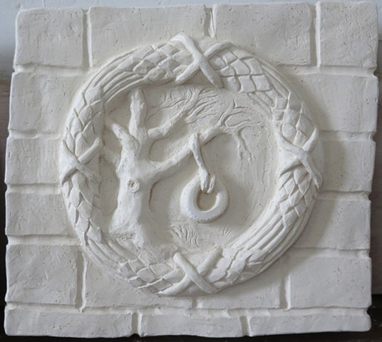 clay relief with contemporary scene of tire swing in a classical rondel frame